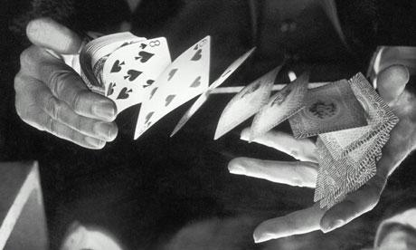 A man shuffling a deck of cards